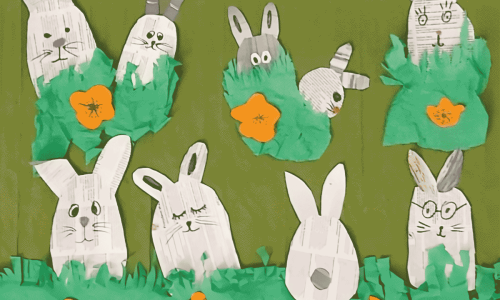 Na zielonej łące bawią się zające